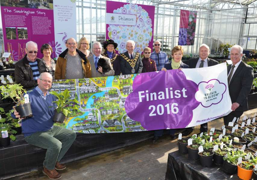 Wisbech in Bloom launches its 2016 campaign at Delamore Young Plants in Wisbech St Mary. Wisbech Mayor and Mayoress David and Judy Hodgson (centre) are pictured at the launch with Wisbech in Bloom chairman Brian Massingham (second right), secretary Penny Stocks (third right), Bob Ollier, parks and open spaces manager for Fenland District Council (right),'Delamore managing director Wayne Eady (front left), along with other guests at the event.