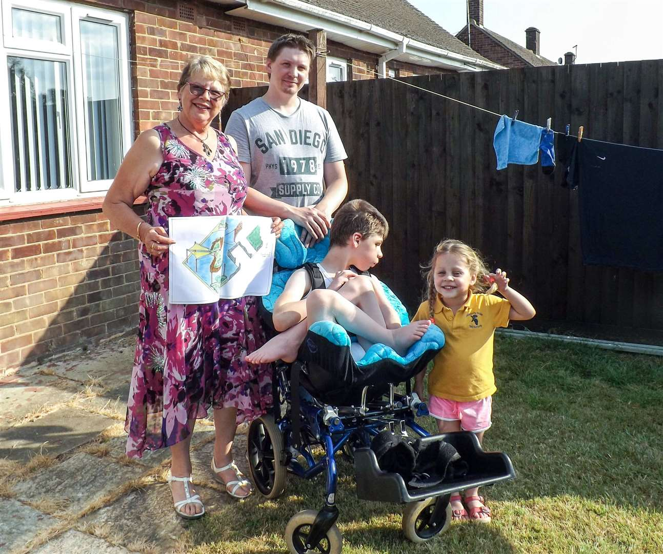 An appeal has been launched to raise money for a sensory garden for Joseph Farmer pictured here with Carol Alderton, dad Daniel and sister Isla, 3. (2949553)