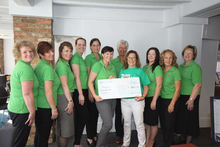Staff from Ellis Winters & Co present a cheque to Jill Smith