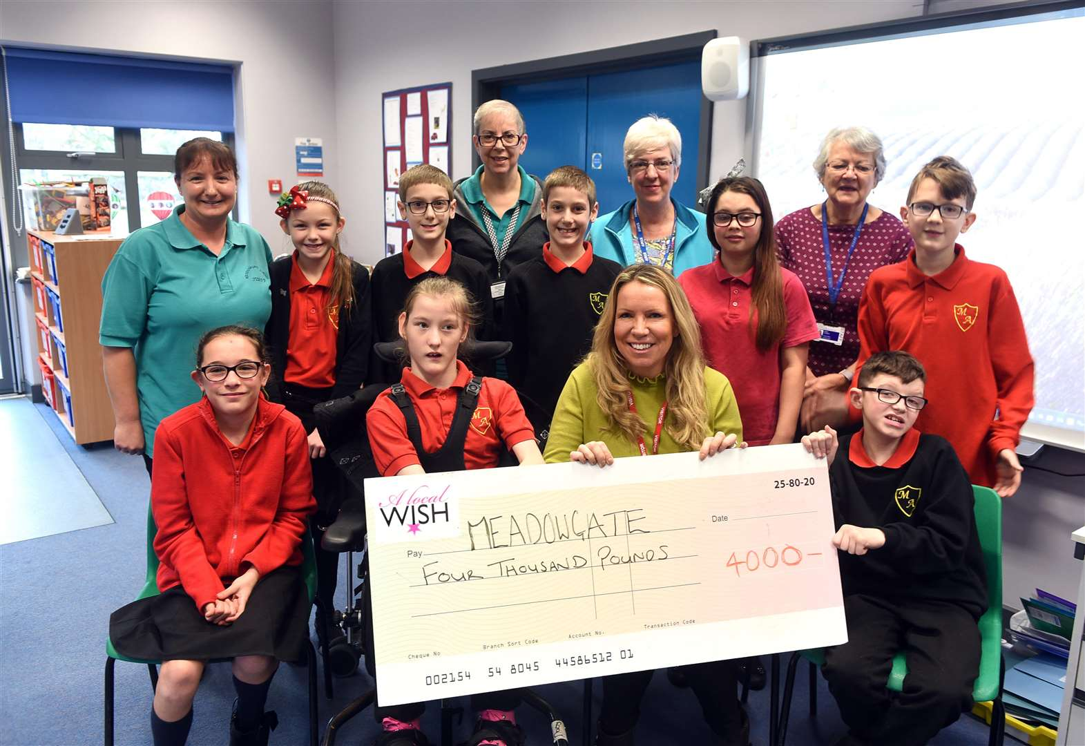 Wisbech-based A Local Wish hands over £4,000 to Meadowgate Academy's minibus appeal