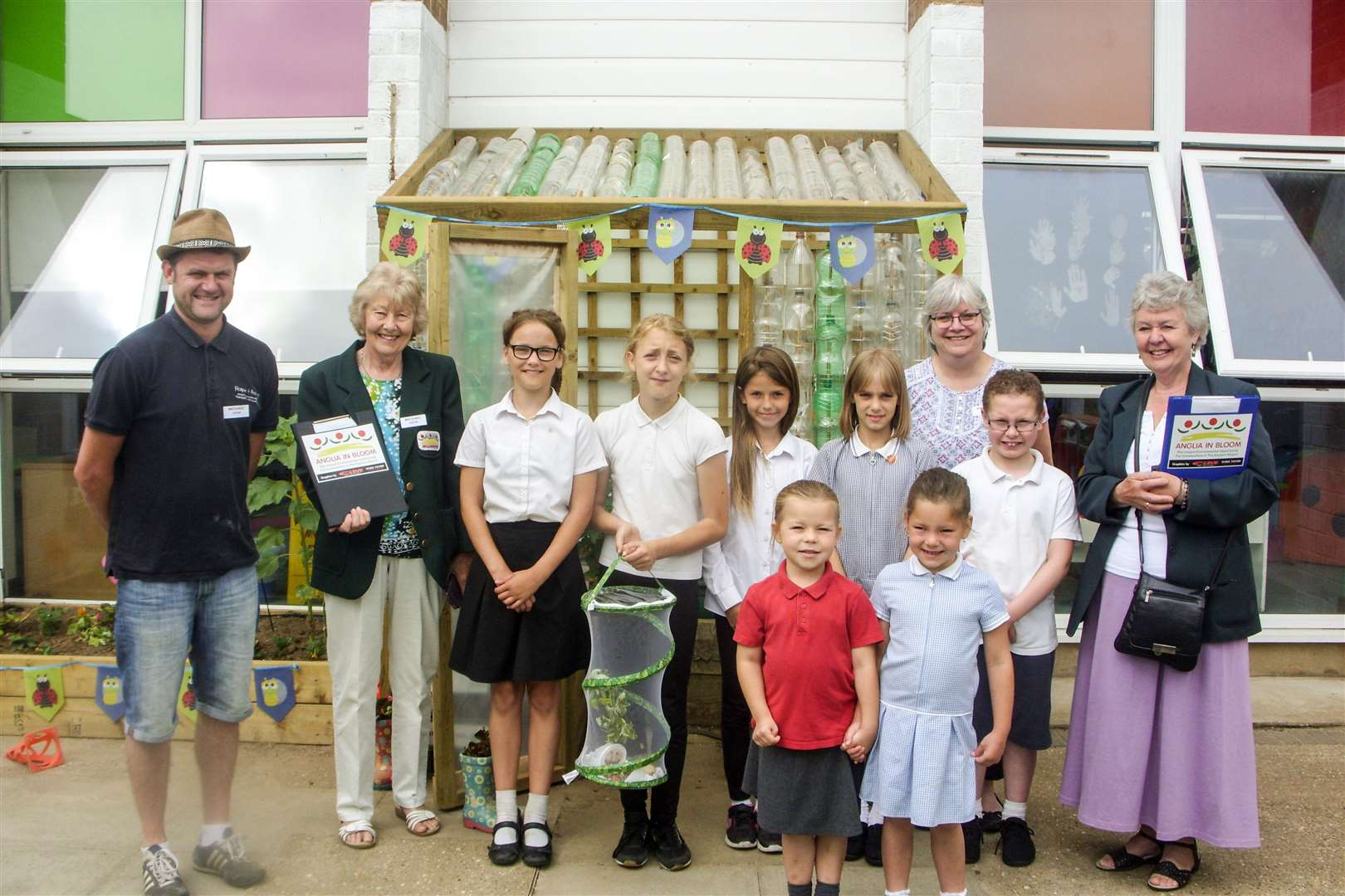 Members of the Orchards Academy's Litter Bugs team with the Anglia in Bloom judges and the greenhouse they have built out of old plastic bottles. (3061340)