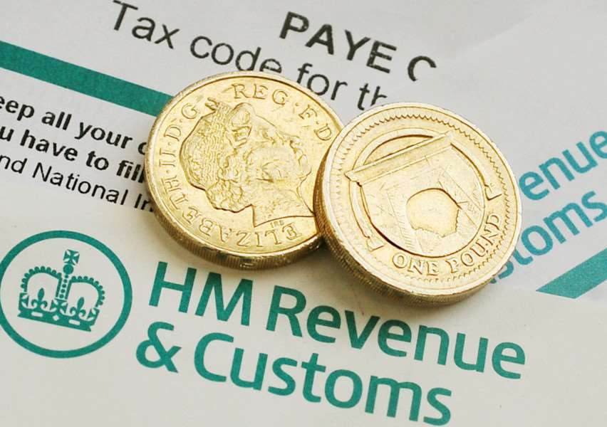 File photo dated 18/03/13 of pound coins on HM Revenue & Customs forms. George Osborne will make a pitch to ordinary working people today when he delivers his penultimate Budget before the general election. PRESS ASSOCIATION Photo. Issue date: Wednesday March 19, 2014. See PA BUDGET stories. Photo credit should read: Rui Vieira/PA Wire PPP-140320-155257001
