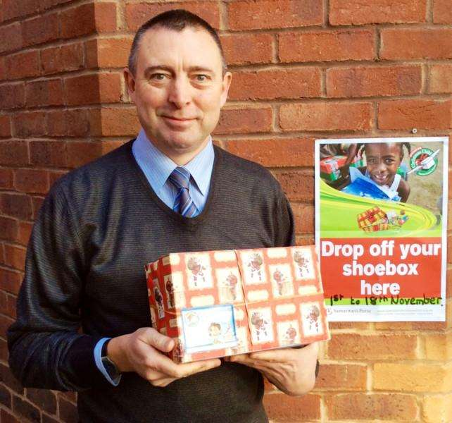 Horsefair Centre manager Kevin Smith with one of the festive shoeboxes.