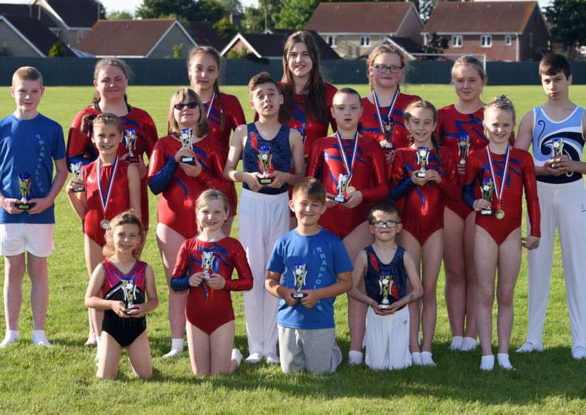 Fenland Flyers trampolining club with medals and trophies