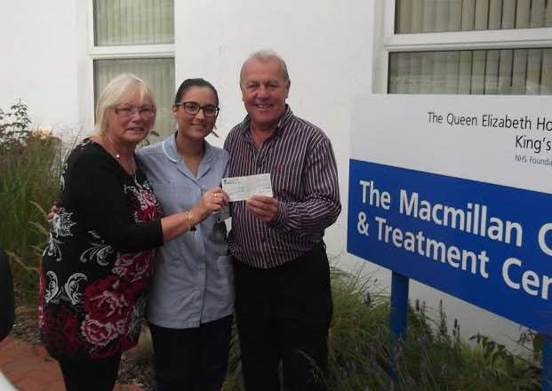 Elizabeth and Roy Mcmanus present the cheque to a nurse at Lynn's Queen Elizabeth Hospital