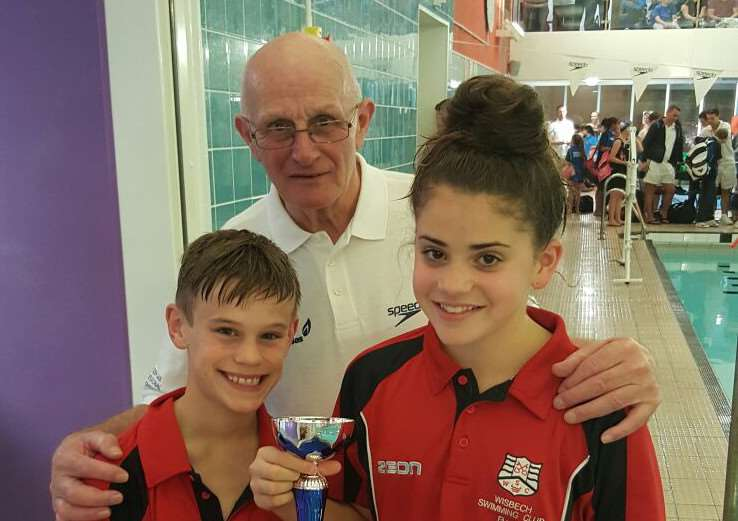Wisbech Junior Fenland League team captains Ben Eden and Beth Dennis received the second place trophy from referee and long-standing Wisbech supporter Mick Rayner.