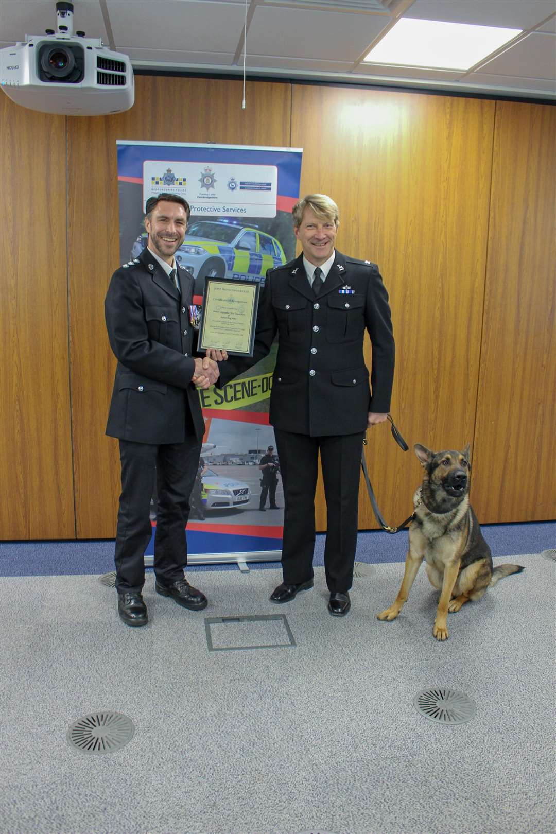 Chief Inspector Robin Sissons (left) awarding the certificate to PC Clive Warncken and police dog Max (6158645)