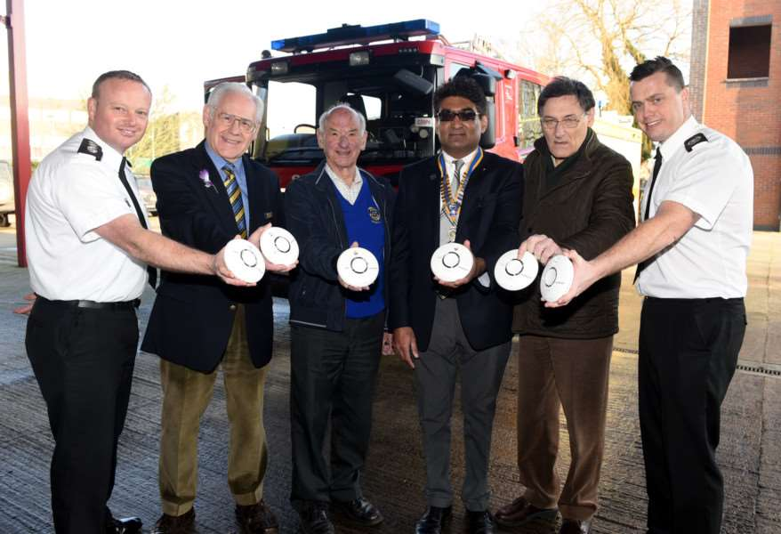 Wisbech Rotary Club funds community fire alarms for vulnerable residents.'Pictured, from left, are Station Commander Brett Mills, rotarians Bill Redmayne, Mike Theobald, Rotary Club president Daljit Roy and Mark Vawseir , with head of community safety Chris Parker.