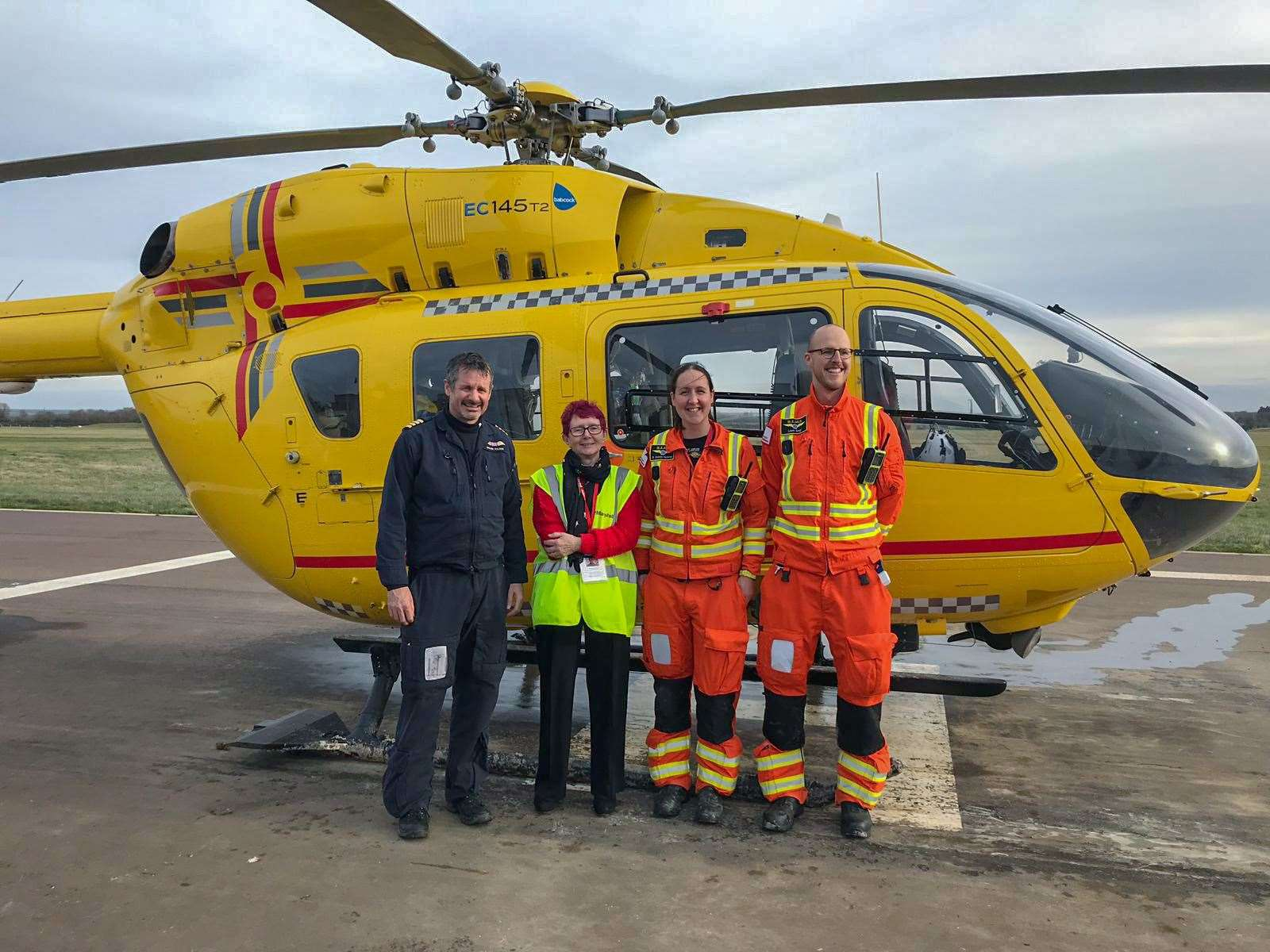 Sue Scarlett with the East Anglian Air Ambulance crew she says saved her life. (8265591)