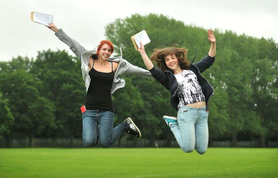 A Level Results - Students at KES get their results. Jenny Slade (left) and Rebecca Hubble jump for joy. ENGANL00120130815104415