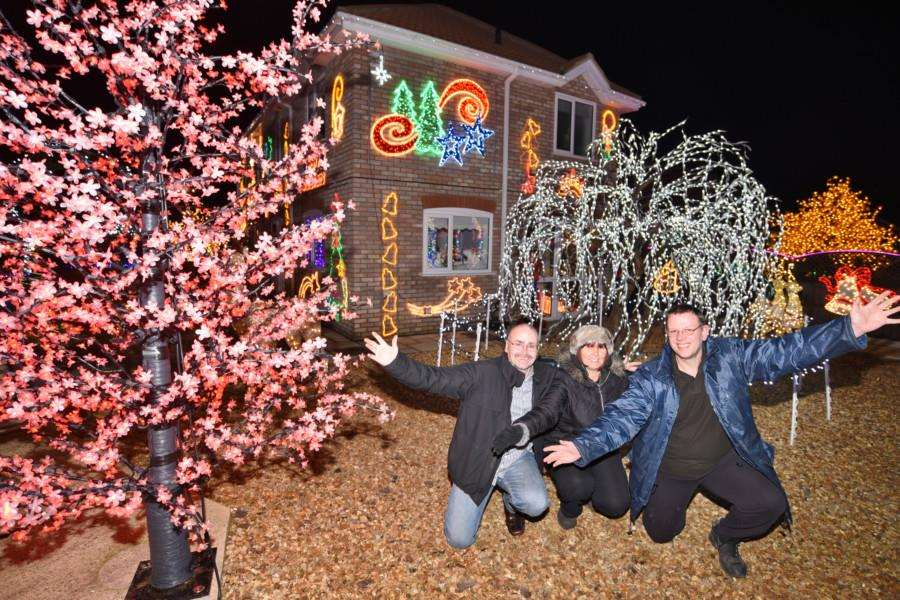 Christmas lights at Duncombes Road, Turves. Robert and Amanda Dempsey with helper Phil Hall EMN-161129-192954009