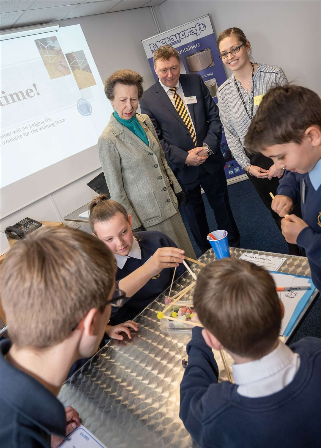 Princess Anne watches Kingsfield Pupils work alongside apprentices to solve an engineering task to build a tall tower using sticks and sweets. (8155789)