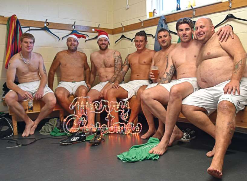 Macmillan FC players pose for their fundraising charity calendar