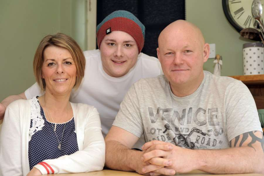 Billy Lee with his mum and dad Rebecca and Spencer Lee with the news that they have reached their target of ?70,000 so he can have a prosthetic leg ANL-150504-205825009