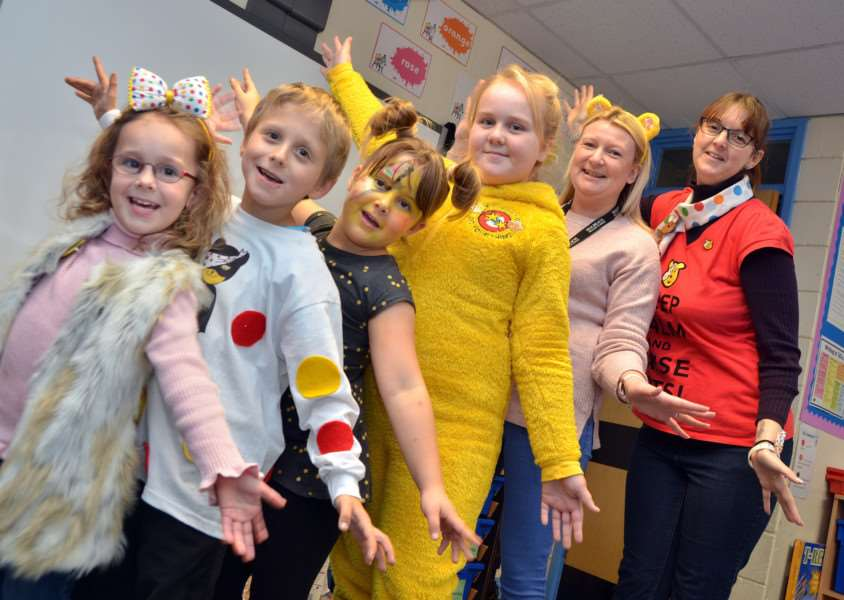 CHILDREN IN NEED: Holbeach Primary Academy pupils Lacie, Daniel, Alexis and Lacie with staff members Ann Rickers and Emma Rout. Photo by Tim Wilson. SG171117-119TW.