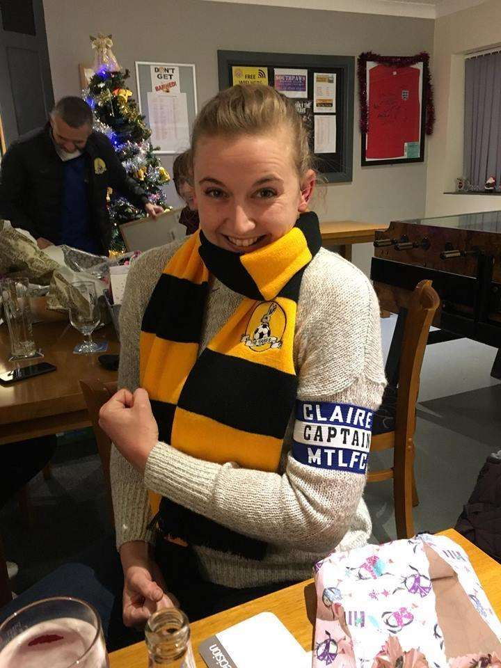 March club captain Claire Newton wearing her 'secret Santa' prizes after the game. (6042059)