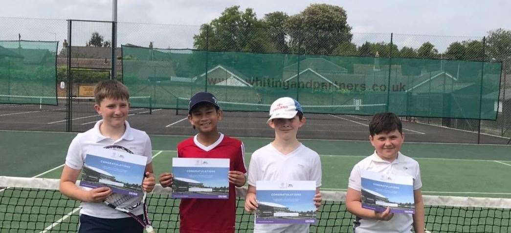 LK Road to Wimbledon boys' winner Liam Garcia (second left); runner-up Oliver Appleby is also in the photo.
