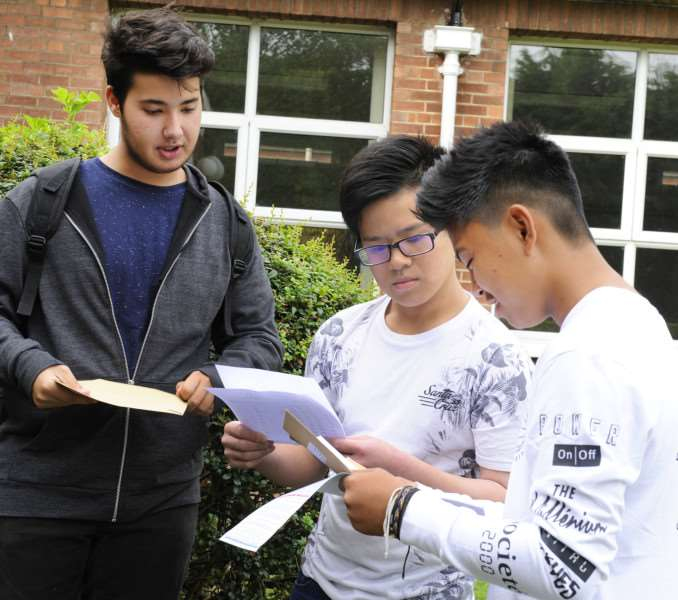 GCSE Results Day for Students at Cromwell Community College Chatteris'Students with results, LtoR, Marceli Marques, Andy Long, James Bautista ANL-160825-131804009