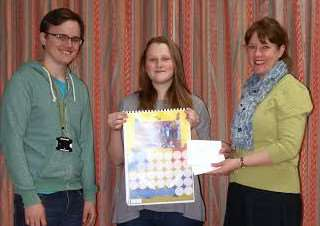 Naomi Cunnington, 18 from Upwell and Adam Flack, 19 from March receiving their prize from Elm Primary School Headteacher Mrs Fiona McCallum.