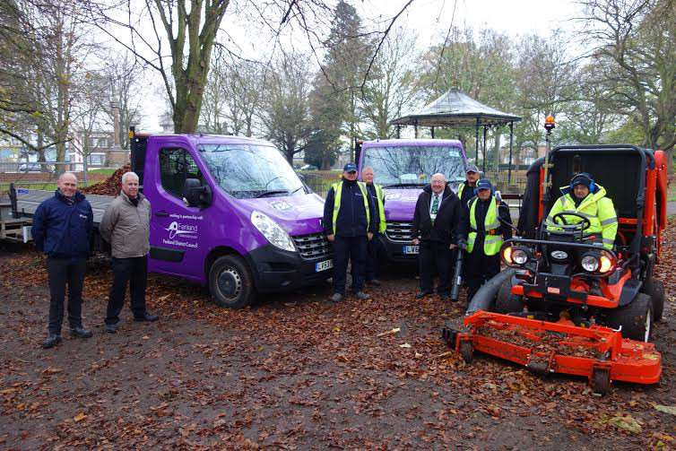 Purple patch: ISS's Marc Pykett (left) with Cllr Peter Murphy, Bob Ollier, FDC's open spaces manager, and ISS staff in Wisbech Park