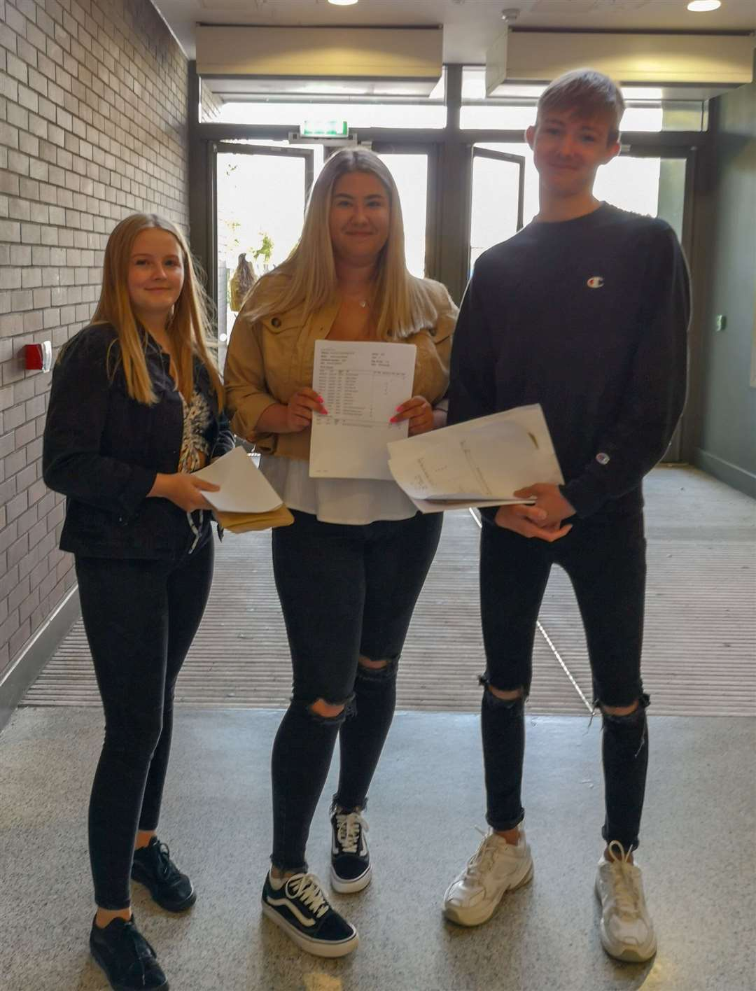 From left: Ellie Dixon, who is remaining at the Neale-Wade to do A-levels and is considering a career as a sports therapist; Molly Rowlett who is off to do biology, chemistry and psychology A-levels at Hills Road in Cambridge and Archie Patterson who was delighted with his results which included 2 9s, and six 8s he is also going to Hills Road to study maths, economics anad government and politics. (15598400)