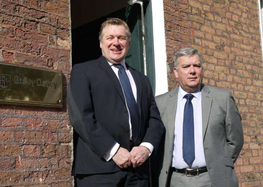Steve Fisher and John Anker pictured out the front of the Bulley Davey office on The Crescent, Wisbech.