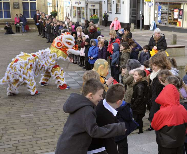 Chinese New Year Celebrations on the Town Square Downham Market, with pupils from some of the local schools enjoying the event. ANL-160802-132457009