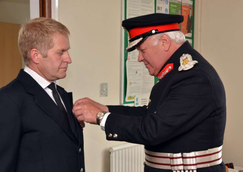 ROYAL APPLAUSE: Richard King receives his British Empire Medal from the Lord Lieutenant of Lincolnshire, Toby Dennis. Photo by Tim Wilson. SG030716-177TW.