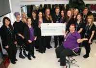 Students and lecturers at the Isle College in Wisbech present the cheque
