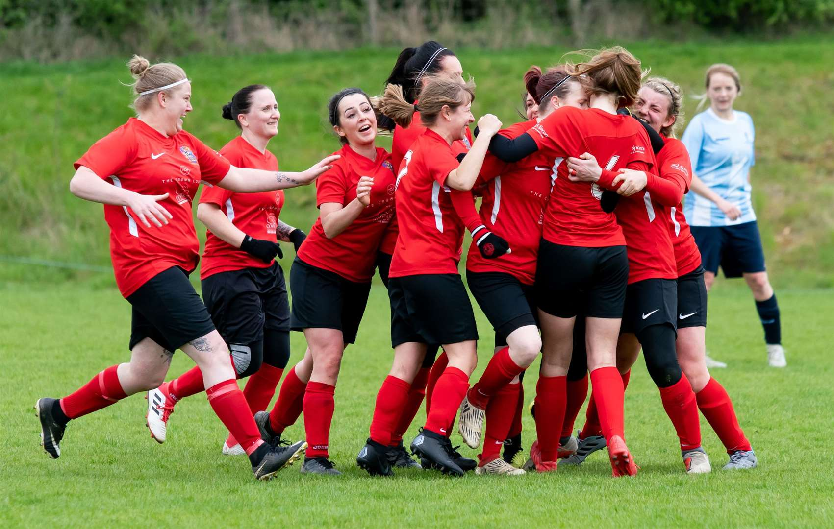 Chelsea King is mobbed after scoring the Wisbech injury time winner. (9384243)