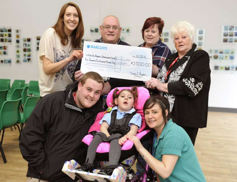 A total of �2,500 raised for Millie Mai Boughen is presented to Meadowgate School in Wisbech. Pictured, back from left, are: class teacher Laura Mills, great uncle Andrew Thorpe, auntie Katiejayne Johnson and great-grandmother Lilly Bailey.'Front, from left, are Millie Mai's dad Ryan Boughen, Millie Mai Boughen, and teaching assistant and carer Fran Warren.