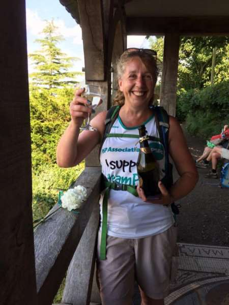 Linda Blatchly toasting dad Mike Brown after completing the Hadrian's Wall walk.