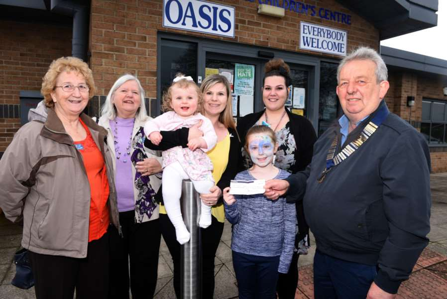 Wisbech Lions present �200 to Maisie O'Brien during a Lego-themed fundraiser at the Oasis Children's Centre in Wisbech. Pictured, from left, are Lions members Avis Gilliatt and Marilyn Battrick, Nicola O'Brien with daughters Maisie and Lottie, 9, Sadie Golding and Bill Battrick.