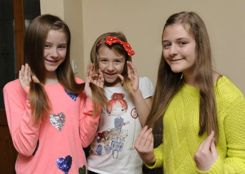 Wisbech sisters having hair cut for charity, LtoR, Ellie-Shae Williams (9), Kacey Williams (6), Shannon Williams (11) ANL-150215-094832009