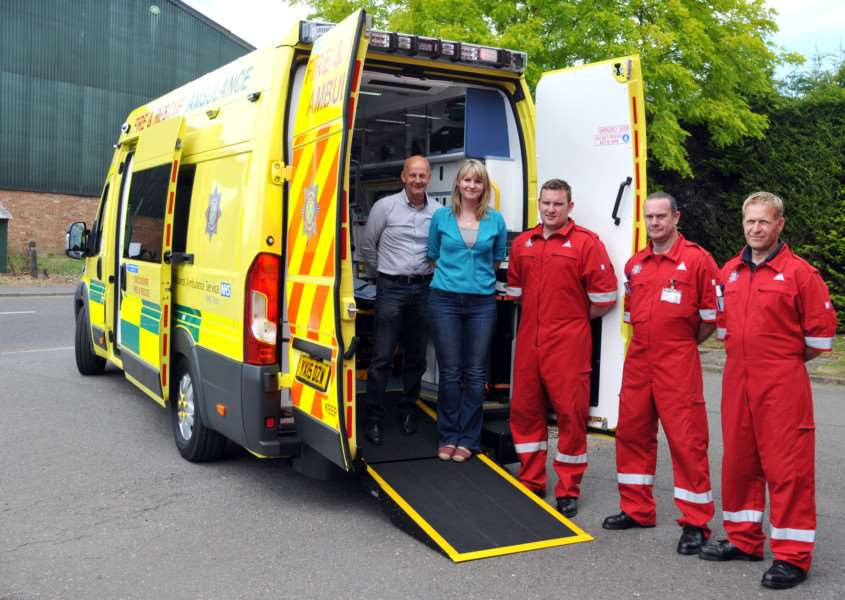 A new ambulance arrives at Long Sutton Fire Station in 2015, welcomed by district councillors Jack Tyrrell and Laura Eldridge, along with retained firefighters Darren Goult, Clive Andrews and Richard King. Photo by Tim Wilson. SG090715-112TW.