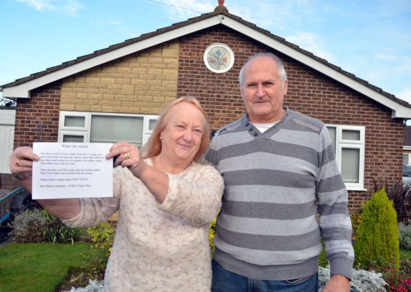 Pauline and Michael Barnacle with their written warning for neighborus. SG191116-172TW