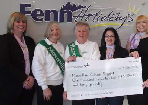 The March branch of the Macmillan Cancer Support group receive the cheque from Fenn Holidays