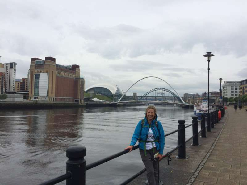 Linda Blatchly walked Hadrian's Wall in memory of her dad Mike Brown. Linda at the Tyne and Millenium Bridges and the BalticFlour Mills in Newcastle on the first day.