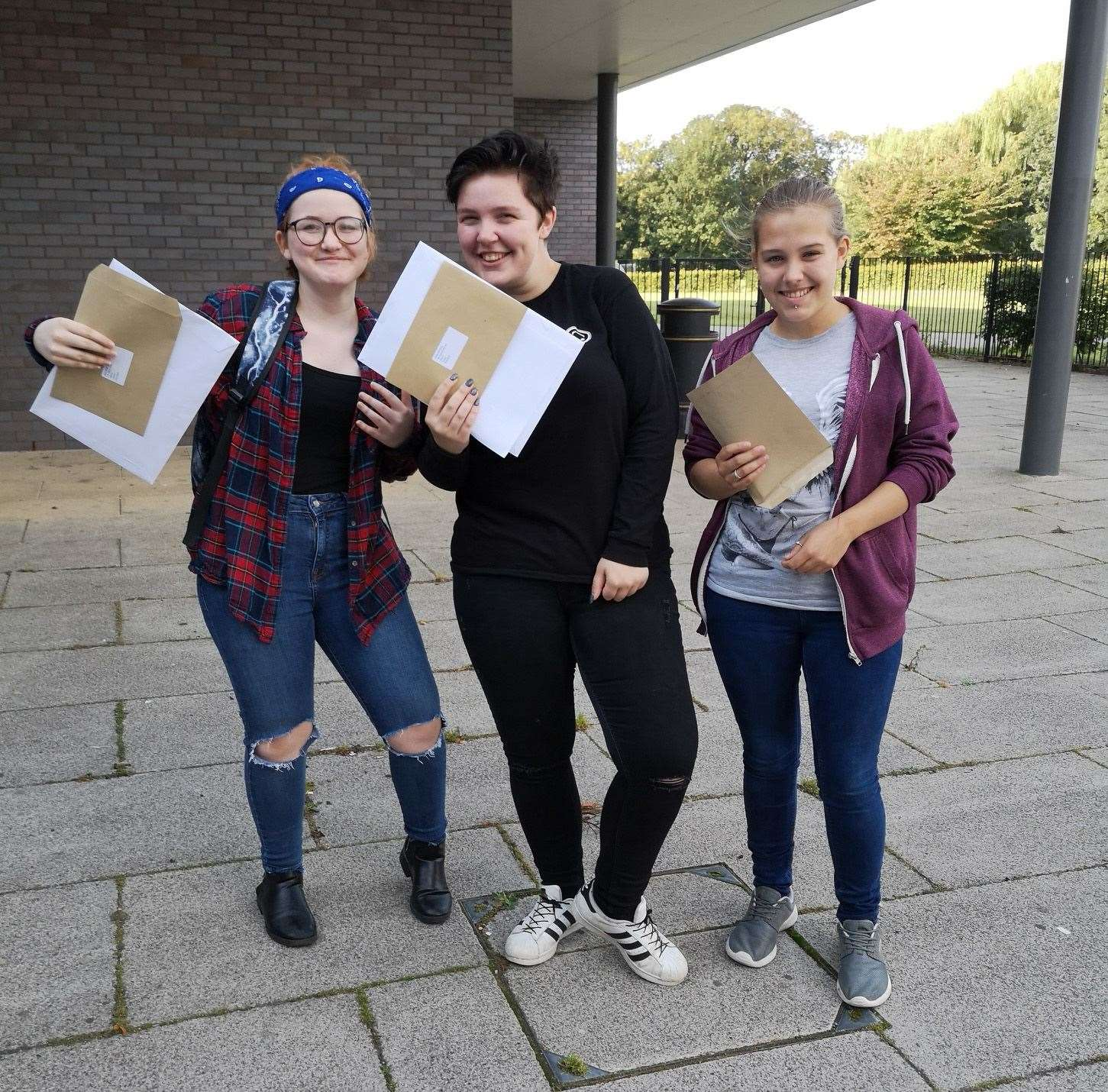 Happy students from left: April King, who is heading to the College of West Anglia to do drama; Holly Gladding who is planning to continue her studies at the Neale-Wade and Jazmin Lewis who is also going to the College of West Anglia to do child care. (15598396)