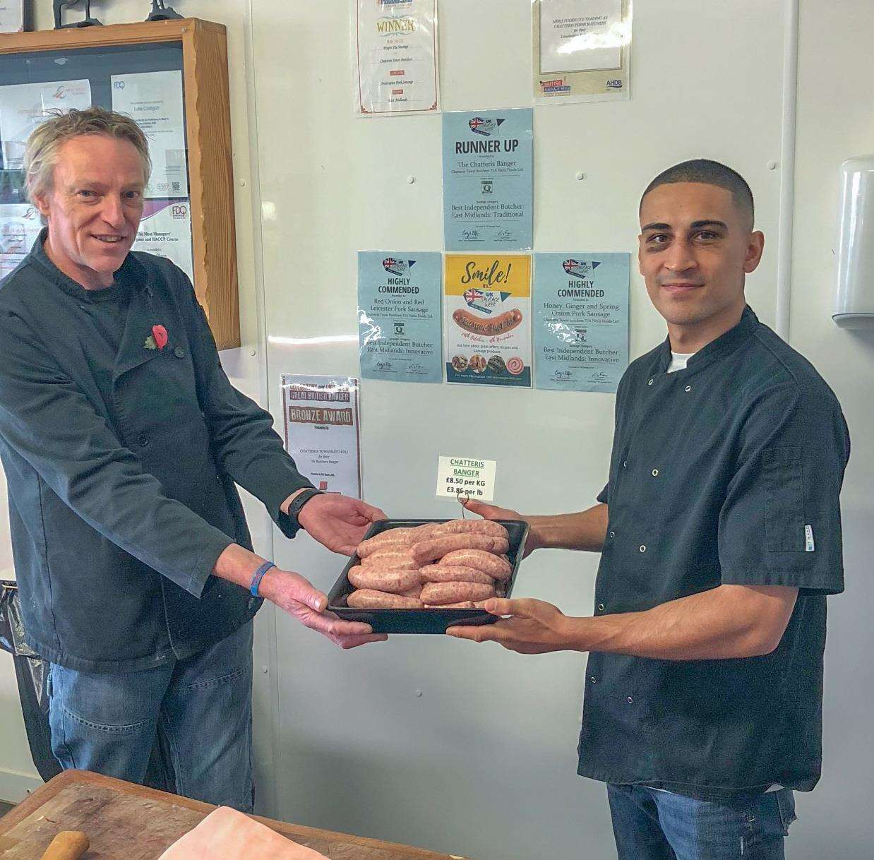 Butcher Nigel Colam with champion boxer Jordan Gill. (5161579)