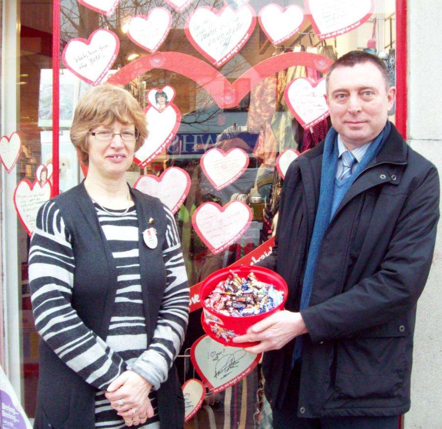 Horsefair manager, Kevin Smith and the Wisbech British Heart Foundation's store manager Janet Kenworthy get ready for Valentine's Day. ENGANL00120140502143838