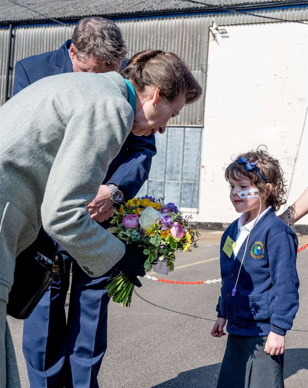 Schoolgirl Kayla Hay presents Princess Anne with a posy at the end of the visit. (8155799)