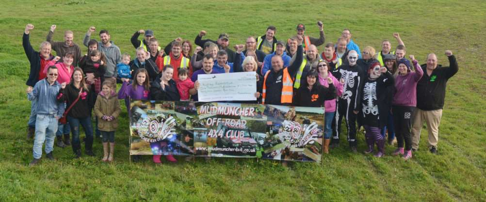Mudmuncher 4x4 off-road club members celebrate as Tim Wedlake and Sue Jackson (right of cheque) present �1,244.54 the club raised for the Kidney Research UK charity to Dale Fisher and his partner, Kelly Back, and their daughter, Leoni.