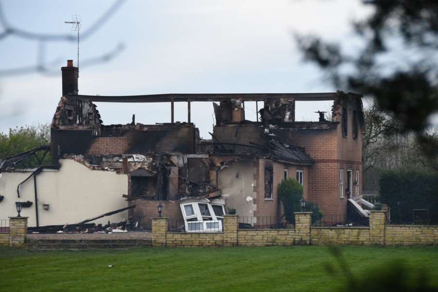 The aftermath of the house fire near Thorney. Photo: David Lowndes