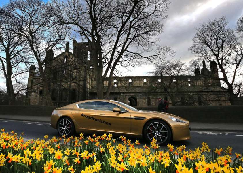 Don't miss the Gold Aston Martin touring north Cambridgeshire this morning