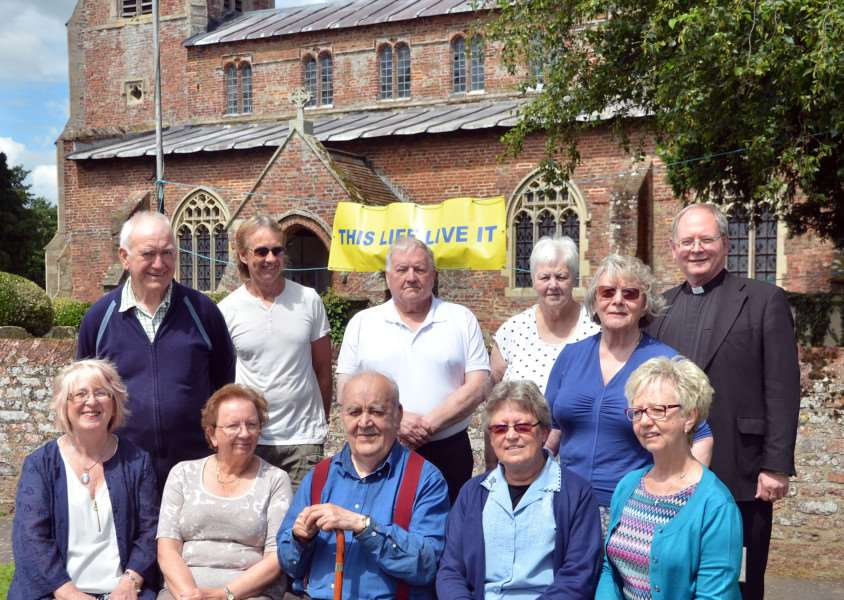 CHURCH CASH I: Parish priest Father Jonathan Sibley (back right) churchwardens and church council members outside St Nicholas Church, Lutton. Photo by Tim Wilson.