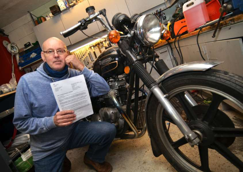 DRIVING COSTS: David Wilkinson with his appeal decision letter from the DVLA after being fined for not renewing his road tax. Photo (TIM WILSON): SG010316-105TW.