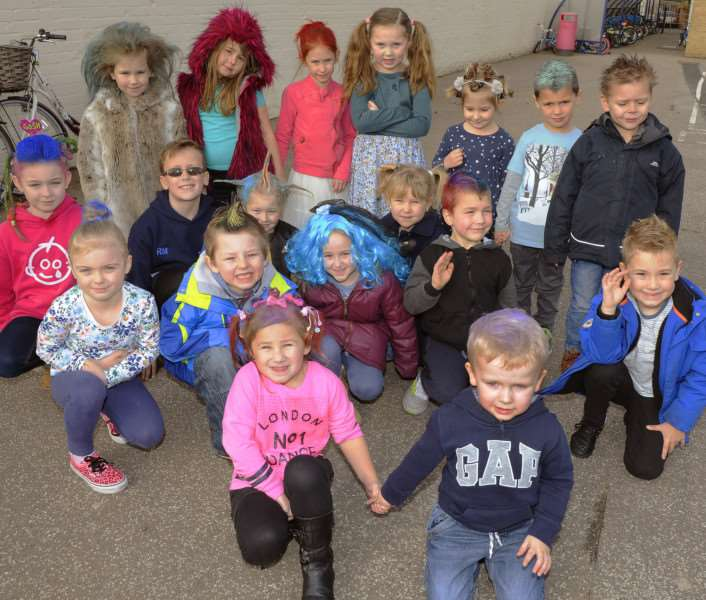 Seven-year-old Ellena Sequerah-Salmon (middle left) joins friends at Burrowmoor Primary School in March for a Bad Hair Day in aid of London's Great Ormond Street Hospital.
