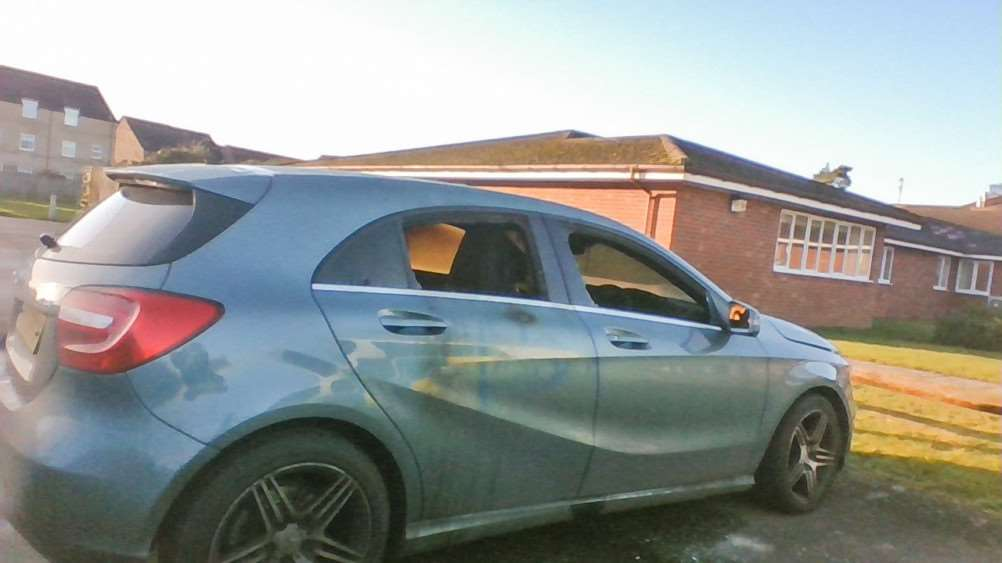 Two cars have been vandalised in Wisbech in an incident police are treating as a hate crime.