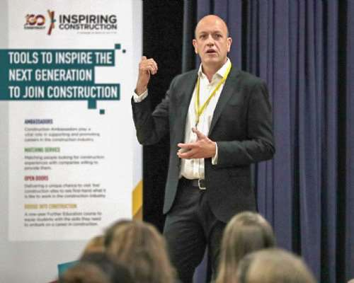 Mark Noonan, industry engagement director of the Construction Industry Training Board gives pupils taste of life on a construction site using a simulator.
